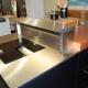 Abverkaufsküche schwarzes Acrylux und Holzfurnier mit Gaggenaugeräten 2