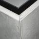 Detail einer Kücheninsel mit Betonfronten und warm gewalzter Edelstahl Arbeitsplatte
